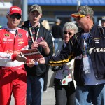 KANSAS CITY, KS - OCTOBER 16:  Kevin Harvick, driver of the #4 Budweiser/Jimmy John's Chevrolet, signs autographs for fans during practice for the NASCAR Sprint Cup Series Hollywood Casino 400 at Kansas Speedway on October 16, 2015 in Kansas City, Kansas.  (Photo by Jerry Markland/Getty Images)