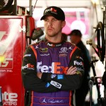 KANSAS CITY, KS - OCTOBER 16:  Denny Hamlin, driver of the #11 FedEx Express Toyota, stands in the garage area during practice for the NASCAR Sprint Cup Series Hollywood Casino 400 at Kansas Speedway on October 16, 2015 in Kansas City, Kansas.  (Photo by Matt Sullivan/Getty Images)