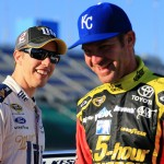 KANSAS CITY, KS - OCTOBER 16: Brad Keselowski, driver of the #2 Miller Lite Ford, talks to Clint Bowyer, driver of the #15 5-hour Energy Toyota, on the grid during qualifying for the NASCAR Sprint Cup Series Hollywood Casino 400 at Kansas Speedway on October 16, 2015 in Kansas City, Kansas.  (Photo by Daniel Shirey/Getty Images)