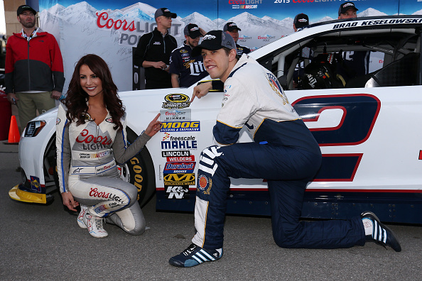 Brad Keselowski, driver of the #2 Miller Lite Ford, poses with Miss Coors Light Amanda Mertz and the Coors Light Pole award after qualifying for pole position for the NASCAR Sprint Cup Series Hollywood Casino 400 at Kansas Speedway on October 16, 2015 in Kansas City, Kansas. (Photo by Todd Warshaw/Getty Images)