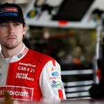 KANSAS CITY, KS - OCTOBER 17:  Ryan Blaney, driver of the #21 Motorcraft/Quick Lane Tire & Auto Center Ford, stands in the garage area during practice for the NASCAR Sprint Cup Series Hollywood Casino 400 at Kansas Speedway on October 17, 2015 in Kansas City, Kansas.  (Photo by Todd Warshaw/Getty Images)