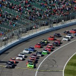 KANSAS CITY, KS - OCTOBER 17: Matt Kenseth, driver of the #20 Reser's Main St. Bistro Toyota, and Chris Buescher, driver of the #60 AdvoCare Ford, lead the field through the green flag to start the NASCAR XFINITY Series Kansas Lottery 300 at Kansas Speedway on October 17, 2015 in Kansas City, Kansas.  (Photo by Jeff Curry/Getty Images)