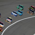 KANSAS CITY, KS - OCTOBER 18: Kyle Busch, driver of the #18 M&M's Halloween Toyota, leads a pack of cars during the NASCAR Sprint Cup Series Hollywood Casino 400 at Kansas Speedway on October 18, 2015 in Kansas City, Kansas.  (Photo by Todd Warshaw/Getty Images)