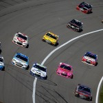 KANSAS CITY, KS - OCTOBER 18:  David Ragan, driver of the #55 Aaron's Online Dream Machine Toyota, Sam Hornish Jr., driver of the #9 Sonic Ford, Casey Mears, driver of the #13 GEICO Chevrolet, and Cole Whitt, driver of the #35 Rich Logistics Ford, lead a pack of cars during the NASCAR Sprint Cup Series Hollywood Casino 400 at Kansas Speedway on October 18, 2015 in Kansas City, Kansas.  (Photo by Todd Warshaw/Getty Images)