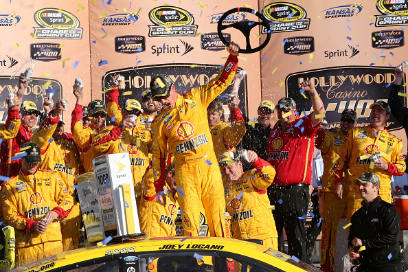 KANSAS CITY, KS - OCTOBER 18:  Joey Logano, driver of the #22 Shell Pennzoil Ford, celebrates in Victory Lane after winning the NASCAR Sprint Cup Series Hollywood Casino 400 at Kansas Speedway on October 18, 2015 in Kansas City, Kansas.  (Photo by Jerry Markland/Getty Images)