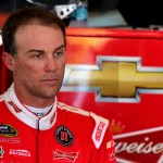 TALLADEGA, AL - OCTOBER 23:  Kevin Harvick, driver of the #4 Budweiser/Jimmy John's Chevrolet, stands in the garage area during practice for the NASCAR Sprint Cup Series CampingWorld.com 500 at Talladega Superspeedway on October 23, 2015 in Talladega, Alabama.  (Photo by Jerry Markland/Getty Images)