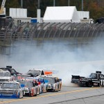 TALLADEGA, AL - OCTOBER 24:  Ben Kennedy, driver of the #11 Local Motors Toyota, and others are involved in an on-track incident during the NASCAR Camping World Truck Series fred's 250 at Talladega Superspeedway on October 24, 2015 in Talladega, Alabama.  (Photo by Brian Lawdermilk/Getty Images)