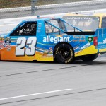 TALLADEGA, AL - OCTOBER 24:  Spencer Gallagher, driver of the #23 Allegiant Chevrolet, and John Wes Townley, driver of the #05 Zaxby's Chevrolet, are involved in an on-track incident during the NASCAR Camping World Truck Series fred's 250 at Talladega Superspeedway on October 24, 2015 in Talladega, Alabama.  (Photo by Brian Lawdermilk/Getty Images)