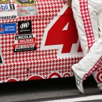 TALLADEGA, AL - OCTOBER 24: Kyle Larson, driver of the #42 Target Plaid Chevrolet, stands on the grid during qualifying for the NASCAR Sprint Cup Series CampingWorld.com 500 at Talladega Superspeedway on October 24, 2015 in Talladega, Alabama.  (Photo by Patrick Smith/Getty Images)