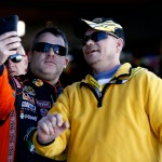 MARTINSVILLE, VA - OCTOBER 30:  (L-R) Tony Stewart, driver of the #14 Bass Pro Shops/Mobil 1 Chevrolet, takes a photo with a fan during practice for the NASCAR Sprint Cup Series Goody's Headache Relief Shot 500 at Martinsville Speedway on October 30, 2015 in Martinsville, Virginia.  (Photo by Jeff Zelevansky/Getty Images)
