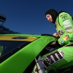 MARTINSVILLE, VA - OCTOBER 30:  Kyle Busch, driver of the #18 M&M's Crispy Toyota, climbs into his car in the garage area during qualifying for the NASCAR Sprint Cup Series Goody's Headache Relief Shot 500 at Martinsville Speedway on October 30, 2015 in Martinsville, Virginia.  (Photo by Rainier Ehrhardt/Getty Images)