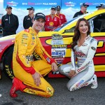 MARTINSVILLE, VA - OCTOBER 30:  Joey Logano, driver of the #22 Shell Pennzoil Ford, poses with Miss Coors Light Amanda Mertz as they affix the Coors Light Pole award decal after qualifying for pole position for for the NASCAR Sprint Cup Series Goody's Headache Relief Shot 500 at Martinsville Speedway on October 30, 2015 in Martinsville, Virginia.  (Photo by Sarah Crabill/Getty Images)