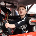 MARTINSVILLE, VA - OCTOBER 31:  Brantley, son of Timothy Peters, driver of the #17 Red Horse Racing Toyota, plays in his car during pre-race ceremonies for the NASCAR Camping World Truck Series Kroger 200 at Martinsville Speedway on October 31, 2015 in Martinsville, Virginia.  (Photo by Jonathan Moore/Getty Images)