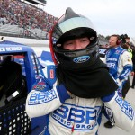 MARTINSVILLE, VA - OCTOBER 31:  Tyler Reddick, driver of the #19 BrdKslwsk'sChckrdFlgFndtn Ford, stands on the grid during pre-race ceremonies for the NASCAR Camping World Truck Series Kroger 200 at Martinsville Speedway on October 31, 2015 in Martinsville, Virginia.  (Photo by Sarah Crabill/Getty Images)