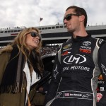 MARTINSVILLE, VA - OCTOBER 31:  Ben Kennedy, driver of the #11 Local Motors Toyota, and his girlfriend Chelsea Saunders stand on the grid during pre-race ceremonies for during the NASCAR Camping World Truck Series Kroger 200 at Martinsville Speedway on October 31, 2015 in Martinsville, Virginia.  (Photo by Jonathan Moore/Getty Images)