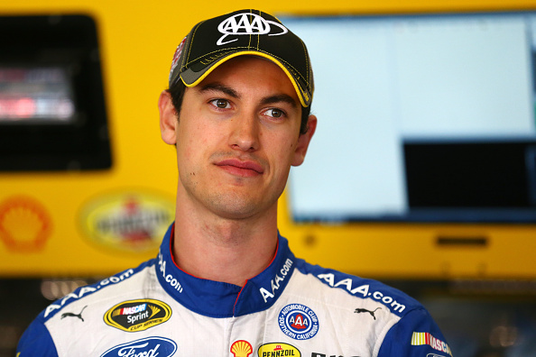 FORT WORTH, TX - NOVEMBER 06:  Joey Logano, driver of the #22 AAA Insurance Ford, stands in the garage area during practice for the NASCAR Sprint Cup Series AAA Texas 500 at Texas Motor Speedway on November 6, 2015 in Fort Worth, Texas.  (Photo by Tom Pennington/Getty Images)