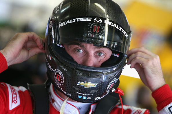 FORT WORTH, TX - NOVEMBER 06:  Kevin Harvick, driver of the #4 Budweiser/Jimmy John's Chevrolet, adjusts his equipment in the garage area during practice for the NASCAR Sprint Cup Series AAA Texas 500 at Texas Motor Speedway on November 6, 2015 in Fort Worth, Texas.  (Photo by Sean Gardner/Getty Images for Texas Motor Speedway)