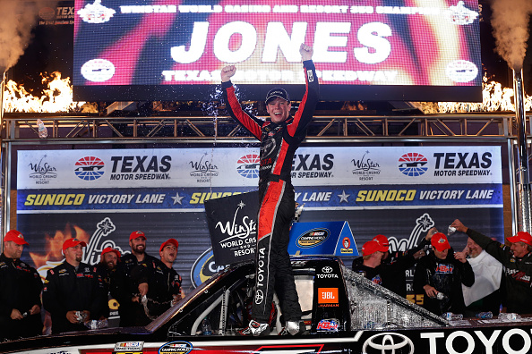 Erik Jones, driver of the #4 Toyota Toyota, celebrates in victory lane after winning the NASCAR Camping World Truck Series WinStar World Casino 350 at Texas Motor Speedway on November 6, 2015 in Fort Worth, Texas. (Photo by Brian Lawdermilk/Getty Images for Texas Motor Speedway)