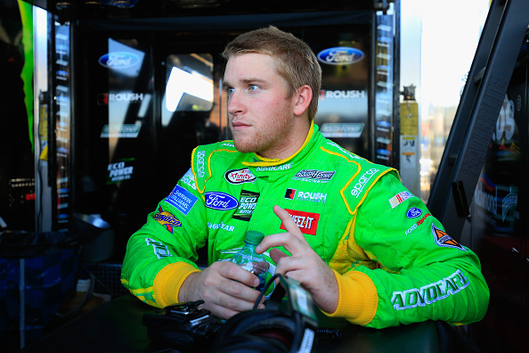 AVONDALE, AZ - NOVEMBER 13:  Chris Buescher, driver of the #60 AdvoCare Ford, stands in the garage area during practice for the NASCAR XFINITY Series DAV 200 Honoring America's Veterans at Phoenix International Raceway on November 13, 2015 in Avondale, Arizona.  (Photo by Chris Trotman/Getty Images)