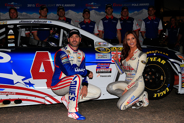 AVONDALE, AZ - NOVEMBER 13:  (L-R) Jimmie Johnson, driver of the #48 Lowe's Patriotic Chevrolet, and Miss Coors Light Amanda Mertz pose with the pole award after qualifying for the NASCAR Sprint Cup Series Quicken Loans Race for Heroes 500 at Phoenix International Raceway on November 13, 2015 in Avondale, Arizona.  (Photo by Chris Trotman/Getty Images)
