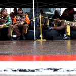 AVONDALE, AZ - NOVEMBER 15:  Crew members for Kyle Busch, driver of the #18 M&M's Crispy Toyota, wait under a canopy during a rain delay for the NASCAR Sprint Cup Series Quicken Loans Race for Heroes 500 at Phoenix International Raceway on November 15, 2015 in Avondale, Arizona.  (Photo by Sean Gardner/Getty Images)