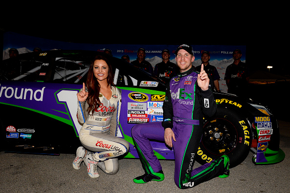 HOMESTEAD, FL - NOVEMBER 20:  Denny Hamlin, driver of the #11 FedEx Ground Toyota, poses with Miss Coors Light Amanda Mertz and the Coors Light Pole award after qualifying for pole position for the NASCAR Sprint Cup Series Ford EcoBoost 400 at Homestead-Miami Speedway on November 20, 2015 in Homestead, Florida.  (Photo by Robert Laberge/Getty Images)