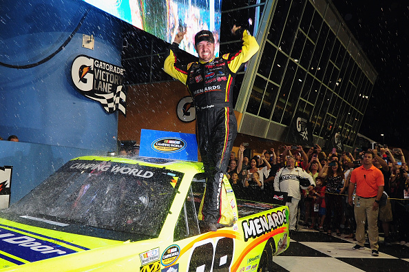 HOMESTEAD, FL - NOVEMBER 20: Matt Crafton, driver of the #88 Ideal Door/Menards Toyota, celebrates in Victory Lane after winning the NASCAR Camping World Truck Series Ford EcoBoost 200 at Homestead-Miami Speedway on November 20, 2015 in Homestead, Florida. (Photo by Jeff Curry/Getty Images)