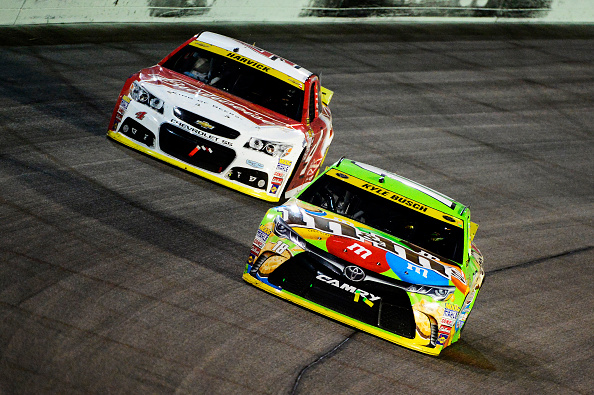 Kyle Busch holds off Kevin Harvick during the NASCAR Sprint Cup Series Ford EcoBoost 400 at Homestead-Miami Speedway on November 22, 2015 in Homestead, Florida.