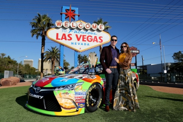 NASCAR Sprint Cup Series champion Kyle Busch poses in front of the Welcome to Fabulous Las Vegas sign during NASCAR Champion's Week on December 1, 2015 in Las Vegas, Nevada.