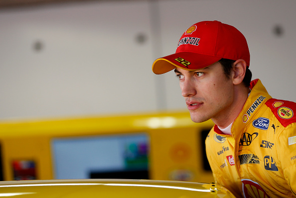DAYTONA BEACH, FL - FEBRUARY 12:  Joey Logano, driver of the #22 Shell Pennzoil Ford, looks on in the garage area during practice for the NASCAR Sprint Cup Series Sprint Unlimited at Daytona International Speedway on February 12, 2016 in Daytona Beach, Florida.  (Photo by Brian Lawdermilk/Getty Images)