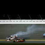DAYTONA BEACH, FL - FEBRUARY 13:  Brian Vickers, driver of the #14 Mobil 1 Chevrolet, Clint Bowyer, driver of the #15 5-hour Energy Chevrolet, and Aric Almirola, driver of the #43 Smithfield Ford, are involved in an on-track incident during the NASCAR Sprint Cup Series Sprint Unlimited at Daytona International Speedway on February 13, 2016 in Daytona Beach, Florida.  (Photo by Jeff Zelevansky/Getty Images)