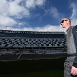 DAYTONA BEACH, FL - FEBRUARY 14:  Josh Wise, driver of the #30 Curtis Key Plumbing Chevrolet, walks down the grid during qualifying for the NASCAR Sprint Cup Series Daytona 500 at Daytona International Speedway on February 14, 2016 in Daytona Beach, Florida.  (Photo by Matt Sullivan/Getty Images)