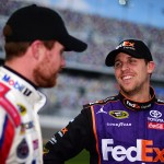 DAYTONA BEACH, FL - FEBRUARY 14:  Denny Hamlin, driver of the #11 FedEx Express Toyota, talks with Brian Vickers, driver of the #14 Bass Pro Shops/Mobil 1 Chevrolet, on the grid during qualifying for the NASCAR Sprint Cup Series Daytona 500 at Daytona International Speedway on February 14, 2016 in Daytona Beach, Florida.  (Photo by Jared C. Tilton/Getty Images)