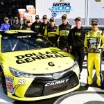 DAYTONA BEACH, FL - FEBRUARY 14:  Matt Kenseth, driver of the #20 Dollar General Toyota, and his crew members pose after winning the Front Row Award after qualifying for the NASCAR Sprint Cup Series Daytona 500 at Daytona International Speedway on February 14, 2016 in Daytona Beach, Florida.  (Photo by Jared C. Tilton/Getty Images)