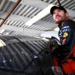 DAYTONA BEACH, FL - FEBRUARY 19: Brian Vickers, driver of the #14 Bass Pro Shops/Mobil 1 Chevrolet, climbs into his car during practice for the NASCAR Sprint Cup Series Daytona 500 at Daytona International Speedway on February 19, 2016 in Daytona Beach, Florida.  (Photo by Sean Gardner/Getty Images)