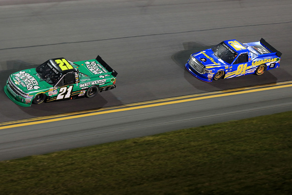 DAYTONA BEACH, FL - FEBRUARY 19:  Johnny Sauter, driver of the #21 Smokey Mountain Herbal Snuff Chevrolet, leads Ryan Truex, driver of the #81 Toyota Osaka Parts Distributor Toyota, during the NASCAR Camping World Truck Series NextEra Energy Resources 250 at Daytona International Speedway on February 19, 2016 in Daytona Beach, Florida.  (Photo by Mike Ehrmann/Getty Images)