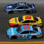 DAYTONA BEACH, FL - FEBRUARY 21: Dale Earnhardt Jr., driver of the #88 Nationwide Chevrolet, races Joey Logano, driver of the #22 Shell Pennzoil Ford, and Aric Almirola, driver of the #43 Smithfield Ford, during the NASCAR Sprint Cup Series DAYTONA 500 at Daytona International Speedway on February 21, 2016 in Daytona Beach, Florida.  (Photo by Sean Gardner/Getty Images)