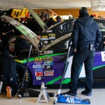 HAMPTON, GA - FEBRUARY 26: Crew members work on the car of Denny Hamlin, driver of the #11 FedEx Ground Toyota, in the garage area during practice for the NASCAR Sprint Cup Series Folds of Honor QuikTrip 500 at Atlanta Motor Speedway on February 26, 2016 in Hampton, Georgia.  (Photo by Kevin C. Cox/Getty Images)