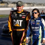 HAMPTON, GA - FEBRUARY 26:  Ryan Newman, driver of the #31 Caterpillar Chevrolet, and Danica Patrick, driver of the #10 Aspen Dental Chevrolet, walk on the grid during qualifying for the NASCAR Sprint Cup Series Folds of Honor QuikTrip 500 at Atlanta Motor Speedway on February 26, 2016 in Hampton, Georgia.  (Photo by Matt Hazlett/Getty Images)