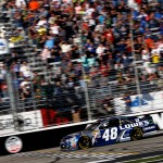 HAMPTON, GA - FEBRUARY 28: Jimmie Johnson, driver of the #48 Lowe's Chevrolet, takes the checkered flag to win the NASCAR Sprint Cup Series Folds of Honor QuikTrip 500 at Atlanta Motor Speedway on February 28, 2016 in Hampton, Georgia.  (Photo by Brian Lawdermilk/Getty Images)