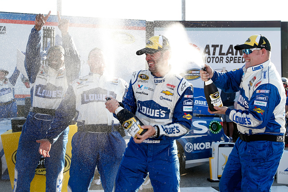 Jimmie Johnson celebrates his win after the NASCAR Sprint Cup Series Folds of Honor QuikTrip 500 at Atlanta Motor Speedway on February 28, 2016 in Hampton, Georgia.