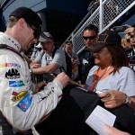 LAS VEGAS, NV - MARCH 05:  Carl Edwards, driver of the #19 Arris Toyota, signs autographs for fans in the garage area during practice for the NASCAR Sprint Cup Series Kobalt 400 at Las Vegas Motor Speedway on March 5, 2016 in Las Vegas, Nevada.  (Photo by Robert Laberge/Getty Images)