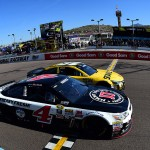 AVONDALE, AZ - MARCH 13:  Kevin Harvick, driver of the #4 Jimmy John's Chevrolet, takes the checkered flag ahead of Carl Edwards, driver of the #19 Stanley Toyota, to win the NASCAR Sprint Cup Series Good Sam 500 at Phoenix International Raceway on March 13, 2016 in Avondale, Arizona.  (Photo by Jared C. Tilton/Getty Images)