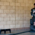 FONTANA, CA - MARCH 18:  Martin Truex Jr., driver of the #78 Furniture Row Toyota, looks on in the garage area during practice for the NASCAR Sprint Cup Series Auto Club 400 at Auto Club Speedway on March 18, 2016 in Fontana, California.  (Photo by Jonathan Ferrey/Getty Images)