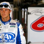 FONTANA, CA - MARCH 19:  Trevor Bayne, driver of the #6 AdvoCare Ford, stands in the garage area during practice for the NASCAR Sprint Cup Series Auto Club 400 at Auto Club Speedway on March 19, 2016 in Fontana, California.  (Photo by Jonathan Ferrey/Getty Images)