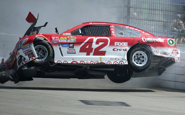 Kyle Larson crashes during the NASCAR Sprint Cup Series Auto Club 400 at Auto Club Speedway on March 20, 2016 in Fontana, California.