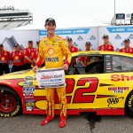 MARTINSVILLE, VA - APRIL 01:  Joey Logano, driver of the #22 Shell Pennzoil Ford, poses with the Coors Light Pole Award after qualifying for pole position for the NASCAR Sprint Cup Series STP 500 at Martinsville Speedway on April 1, 2016 in Martinsville, Virginia.  (Photo by Brian Lawdermilk/Getty Images)