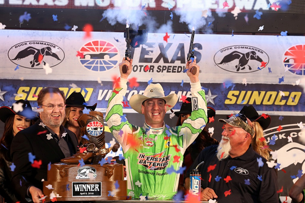 Kyle Busch celebrates winning the NASCAR Sprint Cup Series Duck Commander 500 at Texas Motor Speedway on April 9, 2016 in Fort Worth, Texas. (Getty Images)