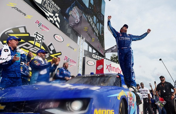 Elliott Sadler celebrates in victory lane at Talladega Saturday.