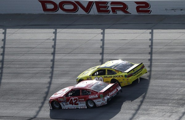 Matt Kenseth and Kyle Larson battle late in the NASCAR Sprint Cup Series AAA 400 Drive for Autism at Dover International Speedway on May 15, 2016 in Dover, Delaware.